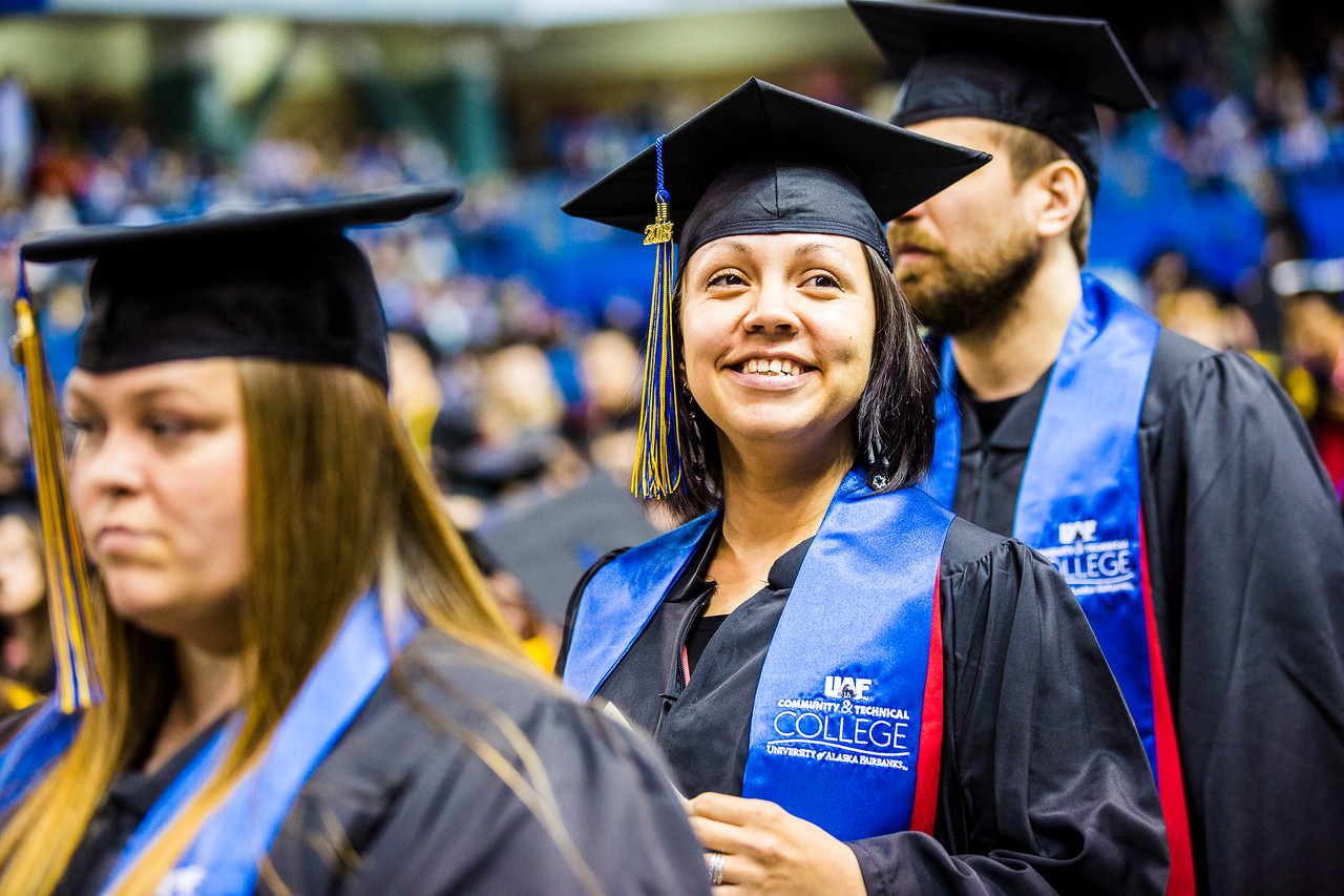 Misty Buckles, who earned a certificate in diesel and heavy equipment mechanics, gazes toward the audience before walking across the stage during UAF's commencement ceremony on May 5, 2018, at the Carlson Center.