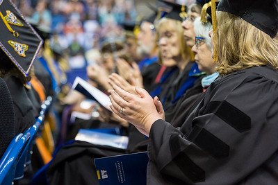 A doctoral candidate clap for peers at the University of Alaska Fairbanks' 97th commencement ceremony at the Carlson Center on Saturday, May 4, 2019.