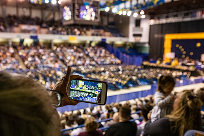A member of the audience records class speaker Jessica K. Obermiller, who earned a bachelor's degree in anthropology, during UAF's commencement ceremony at the Carlson Center on May 4, 2019.