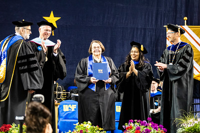 Linda G. Hulbert, who has worked as an educator and education advocate in Alaska for more than 50 years, receives the Meritorious Service Award during University of Alaska Fairbanks' 2019 commencement ceremony at the Carlson Center on May 4, 2019.