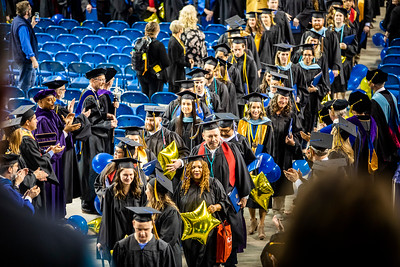Members of the University of Alaska Fairbanks faculty congratulate graduates as they leave the UAF commencement ceremony, held May 4 2019, in the Carlson Center.