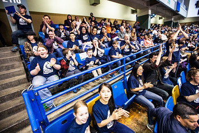 Twenty-one students from the Eagle Community School, along with their chaperones, cheer during the University of Alaska Fairbanks' 97th commencement ceremony on May 4, 2019, in the Carlson Center. The students attended to support their teachers, Kristy Jones-Robbins and Zach Sanders, who received respective master's degrees in special education and secondary education.