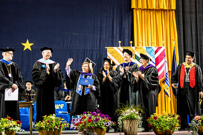 The Rev. Anna M. Frank, who has served Alaskans as a community health aide, counselor and priest for more than 50 years, receives an honorary Doctor of Laws degree during the University of Alaska Fairbanks' 97th commencement ceremony at the Carlson Center May 4, 2019. She received a standing ovation from the audience.