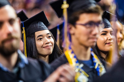 Ajiel Mae Basmayor, who earned a bachelor's degree in biological sciences, listens to class speaker Jessica K. Obermiller during the University of Alaska Fairbanks' 97th commencement ceremony Saturday, May 4, 2019, at the Carlson Center.