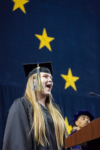 Casey Winkelman, who earned a bachelor's degree in music performance, sings the national anthem during the University of Alaska Fairbanks' 97th commencement ceremony in the Carlson Center on Saturday, May 4, 2019.