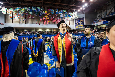 Julian Thibodeau, who received a certificate in rural human services from the University of Alaska Fairbanks' Interior Alaska Campus, smiles at the audience during UAF's commencement ceremony recessional at the Carlson Center on May 4, 2019.