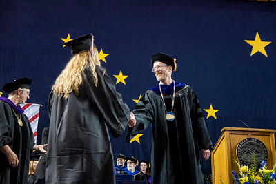 University of Alaska Fairbanks Chancellor Daniel M. White congratulates a graduate on the stage at the 2019 commencement ceremony in the Carlson Center on Saturday, May 4, 2019.