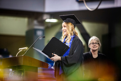 "University of Alaska Fairbanks graduate Ariana Horner sings the state song, ""Alaska's Flag,"" during UAF's 97th commencement ceremony May 4, 2019, at the Carlson Center in Fairbanks. Horner received a bachelor's degree in music education."