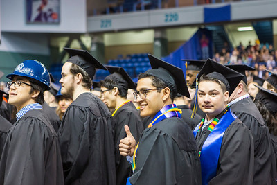 Raymundo Lopez gives a thumbs up while standing with fellow graduates from the College of Engineering and Mines during the University of Alaska Fairbanks' 97th commencement ceremony at the Carlson Center on Saturday, May 4, 2019.