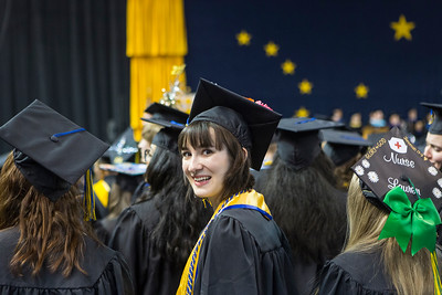Taylor Seitz, who earned a bachelor's degree in biological sciences, waits to walk across the stage at the University of Alaska Fairbanks' 97th commencement ceremony in the Carlson Center on Saturday, May 4, 2019.