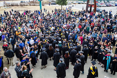 Faculty, staff, community members, friends and family members greet and congratulate University of Alaska Fairbanks graduates outside the Carlson Center after the commencement ceremony May 4, 2019.
