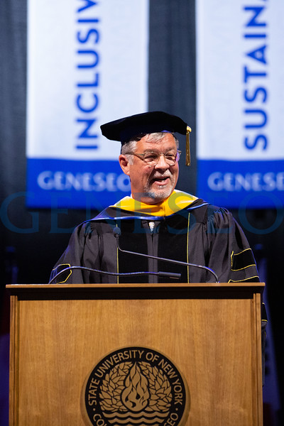 Mark J. Ashley '77 delivers remarks after receiving an honorary degree