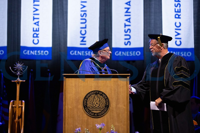 Chair Wayland-Smith and President Battles present Mark J. Ashley '77 with an honrary degree