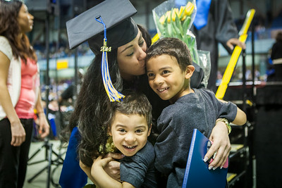 Ciera Shaver is greeted by her sons Mehki Carter, 3, and Maliek Carter, 5 after crossing the stage at the 2014 UAF Commencement Ceremony Sunday, May 11, 2014 at the Carlson Center.  Filename: GRA-14-4187-248.jpg