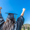 "A happy graduate lifts her fists in triumph outside the Carlson Center before the commencement ceremony May 11.  <div class=""ss-paypal-button"">Filename: GRA-14-4186-0068.jpg</div><div class=""ss-paypal-button-end"" style=""""></div>"
