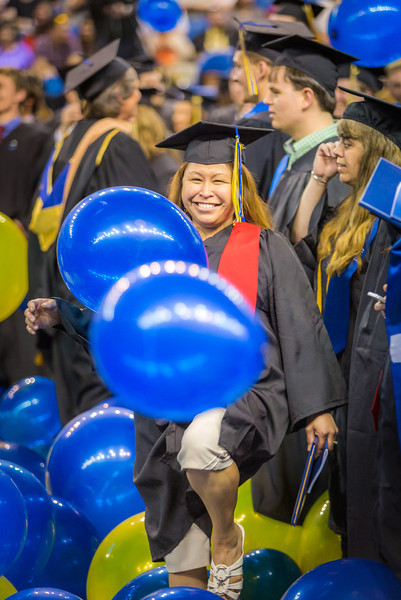 "Jenevie Star Burgess navigates the balloons which fall at the conclusion of UAF's 2014 commencement ceremony.  <div class=""ss-paypal-button"">Filename: GRA-14-4186-1283.jpg</div><div class=""ss-paypal-button-end"" style=""""></div>"