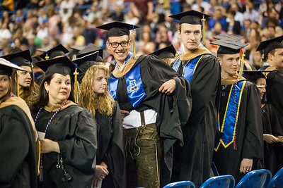 Max Olex, exchange student from Germany, sports his lederhosen during the 2014 Commencement ceremony.  Filename: GRA-14-4187-114.jpg