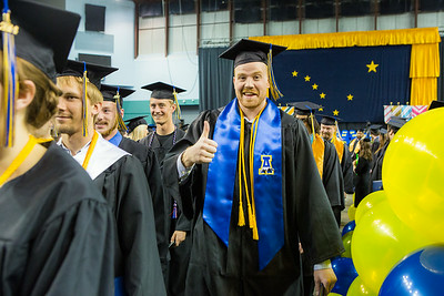Dallen Bills gives thumbs up during the recessional at 2014 Commencement Ceremony. Bills receives a B.A., in Psychology, magna cum laude.  Filename: GRA-14-4187-339.jpg