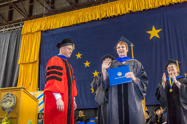 """Rebekah Hare is all smiles after being awarded her Ph.D in biological sciences under the tutelage of Dr. Karsten Hueffer at left.  <div class=""""ss-paypal-button"""">Filename: GRA-14-4186-0940.jpg</div><div class=""""ss-paypal-button-end"""" style=""""""""></div>"""