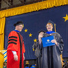 "Rebekah Hare is all smiles after being awarded her Ph.D in biological sciences under the tutelage of Dr. Karsten Hueffer at left.  <div class=""ss-paypal-button"">Filename: GRA-14-4186-0940.jpg</div><div class=""ss-paypal-button-end"" style=""""></div>"