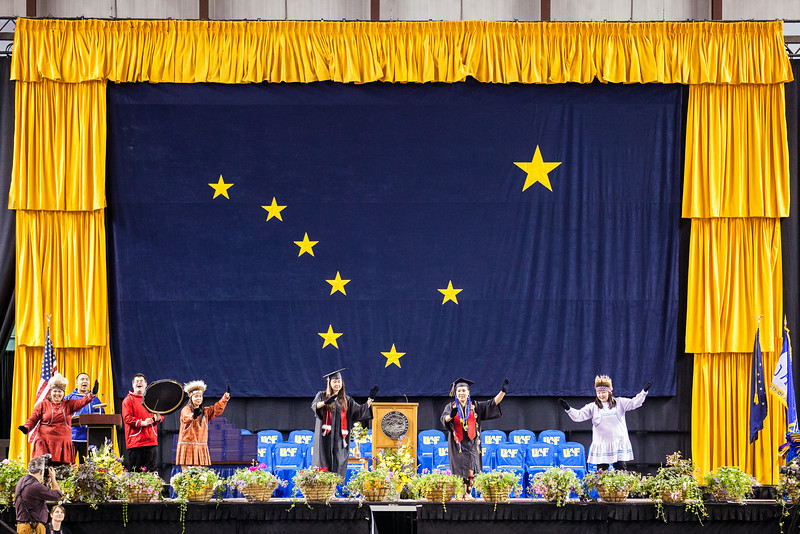 "Members of the UAF Inu-Yupiaq Dance Group dance on the stage before the Processional during the 2014 Commencement Ceremonies Sunday, May 11, 2014 at the Carlson Center.  <div class=""ss-paypal-button"">Filename: GRA-14-4187-71.jpg</div><div class=""ss-paypal-button-end""></div>"