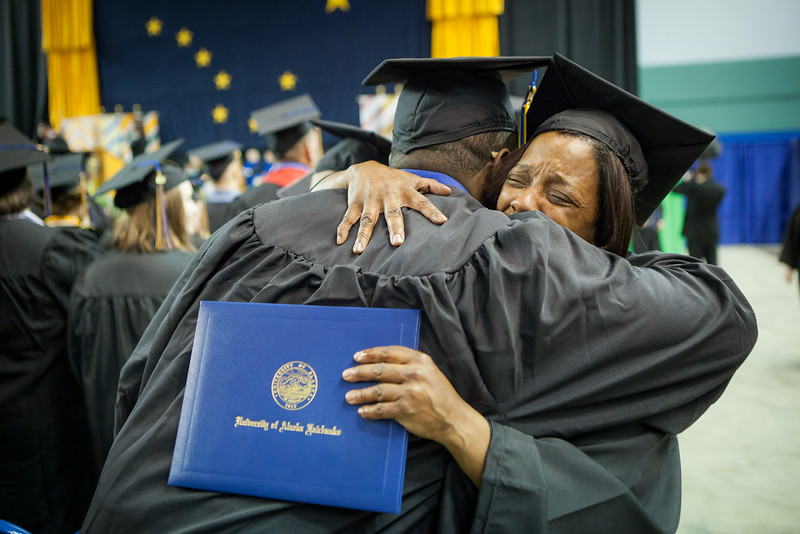 "Dana R. Sweatt embraces another student during the UAF 2014 Commencement Ceremony Sunday, May 11, 2014 at the Carlson Center.  <div class=""ss-paypal-button"">Filename: GRA-14-4187-218.jpg</div><div class=""ss-paypal-button-end""></div>"