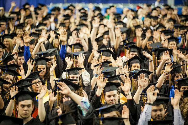 """Graduates raise their hands after a prompt by Class Speaker Ashley Strauch's interactive address during the 2014 UAF Commencement Ceremony at the Carlson Center.  <div class=""""ss-paypal-button"""">Filename: GRA-14-4187-279.jpg</div><div class=""""ss-paypal-button-end""""></div>"""