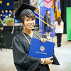 """Student Ambassador Nikki Navio pauses for a photo after walking across the stage with the College of Liberal Arts with a B.A., in Political Science during the 2014 Commencement Ceremony Sunday, May 11, 2014 at the Carlson Center.  <div class=""""ss-paypal-button"""">Filename: GRA-14-4187-210.jpg</div><div class=""""ss-paypal-button-end""""></div>"""