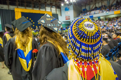 Social work graduate Tonya Esmailka wore some unique headgear during UAF's commencement ceremony May 11 in the Carlson Center.  Filename: GRA-14-4186-0723.jpg