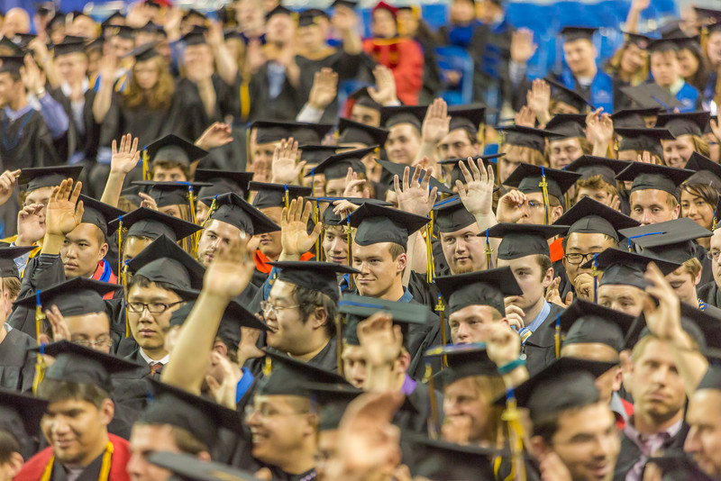 "Graduates raise their hands during an interactive speech delivered by student speaker Ashley Strauch during UAF's commencement ceremony May 11 in the Carlson Center.  <div class=""ss-paypal-button"">Filename: GRA-14-4186-1068.jpg</div><div class=""ss-paypal-button-end"" style=""""></div>"