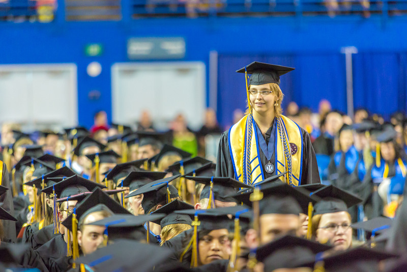 "Ashley Strauch stands from her seat in the crowd as she's recognized for her leadership honors during UAF's commencement ceremony May 11 in the Carlson Center.s  <div class=""ss-paypal-button"">Filename: GRA-14-4186-1035.jpg</div><div class=""ss-paypal-button-end"" style=""""></div>"
