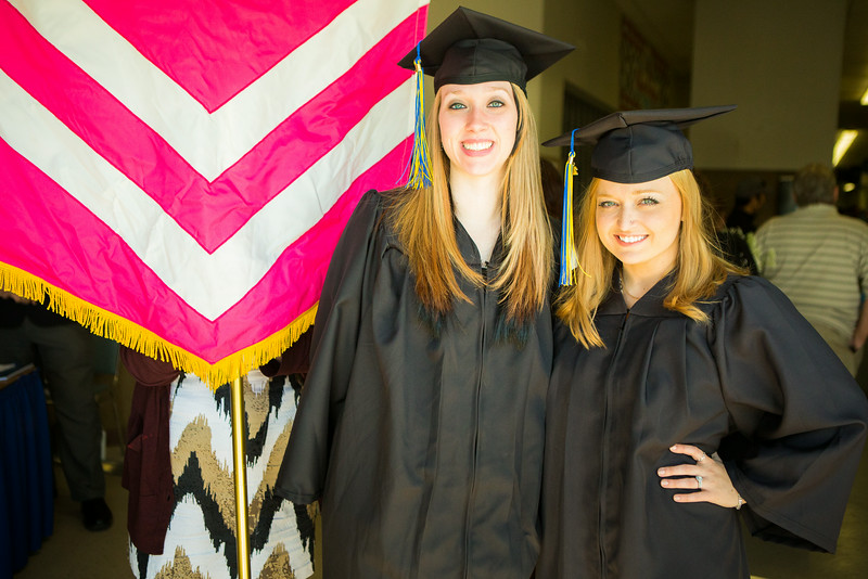 """Amber Harger, left, and Cassandra Haglund pause for a photo before the 2014 Commencement Ceremony.  <div class=""""ss-paypal-button"""">Filename: GRA-14-4187-40.jpg</div><div class=""""ss-paypal-button-end""""></div>"""