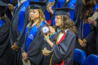 It's appropriate for graduate Jerica Aamodt, with her 3-month-old daughter Jade, that UAF's commencement ceremony traditionally falls on Mother's Day. The 2014 ceremony was Sunday, May 11, in the Carlson Center.  Filename: GRA-14-4186-0250.jpg