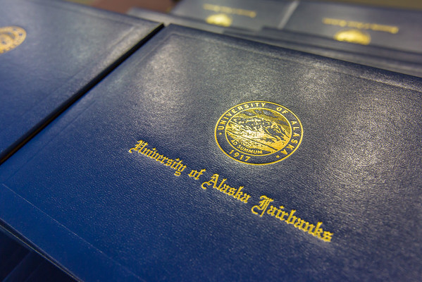 "Diploma covers are ready to be handed out at UAF's 2014 Commencement ceremony May 11 in the Carlson Center.  <div class=""ss-paypal-button"">Filename: GRA-14-4186-0004.jpg</div><div class=""ss-paypal-button-end"" style=""""></div>"