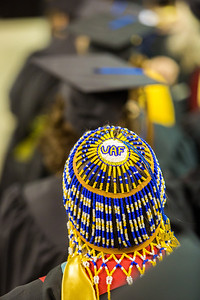 Social work graduate Tonya Esmailka wore some unique headgear during UAF's commencement ceremony May 11 in the Carlson Center.  Filename: GRA-14-4186-0700.jpg