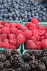 "Close-up of fresh, organically grown berries - raspberries, blueberries, and blackberries.  (To purchase prints or downloads, click on the ""Buy"" or shopping cart button above the image.)"