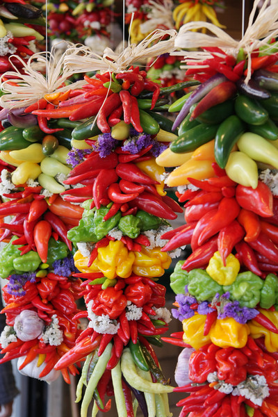"""Colorful and decorative, hanging chili pepper assortment.  (To purchase prints or downloads, click on the """"Buy"""" or shopping cart button above the image.)"""
