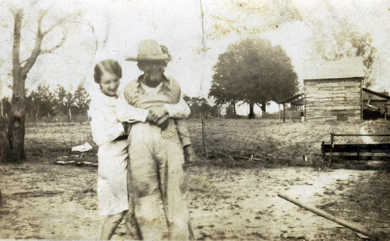 Georgia McKinnon, daughter of Charles and Lillian NeSmith Mckinnon, with father, William Charles McKinnon, son of Reddick Charles and Carrie Anne Jane Goodman McKinnon, circa 1930's, at the Reddick McKinnon homeplace, just south of Ga. 76 and east of Old Valdosta Highway.