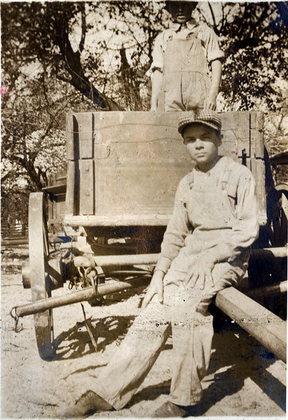 Taking a break after deliveing crops from the John Paulk farm near Alapaha about 1920. This series of photographs documents the farming process in Berrien County about 1920