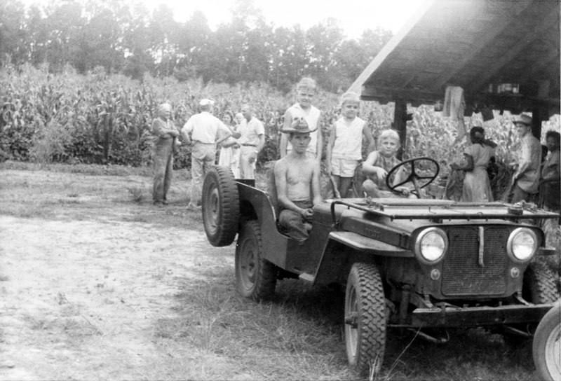 Tobacco harvest time on the W. E. Griffin farm on Flat Creek 1960. Identification needed.