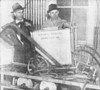 J. D. Tygart, left, manager of the NewIdeal Sprayer Co. and June McNabb. shop assistant,  inspect a two-row, traction type, horse-drawn sprayer.