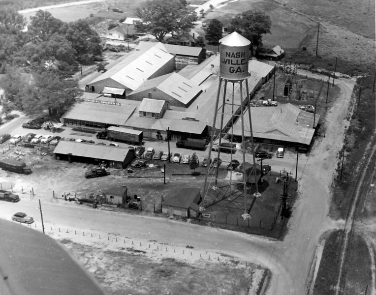 NewIdeal Sprayer Company from the air, about 1955. Also commonly referred to as the Tygart Sprayer Company, manufacturer of farm equipment. Also in the photo is the City Works. Note the Nashville to Sparks railroad bed in the lower right side of photo. Photo courtesy of Ann Tygart Jones.