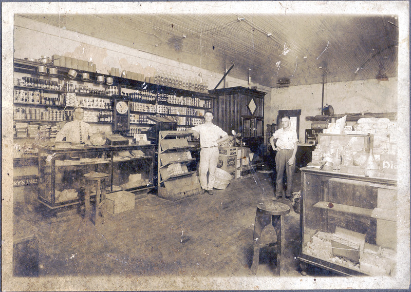 Claude Devane's Grocery Store on East Marion Avenue about 1930. Left to right: Claude Devane, Winston Knight, and Joe Brown Meyer.