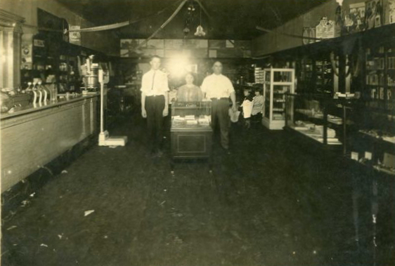 Union Pharmacy, west side of Square in Nashville, circa 1930s. Union Pharmacy was owned by a Dr. Watson. He is shown here with Mrs. Watson and Dr. Buoie L. Bennett. (Courtesy of Zona McGuirt, daughter of Buoie L. Bennett)