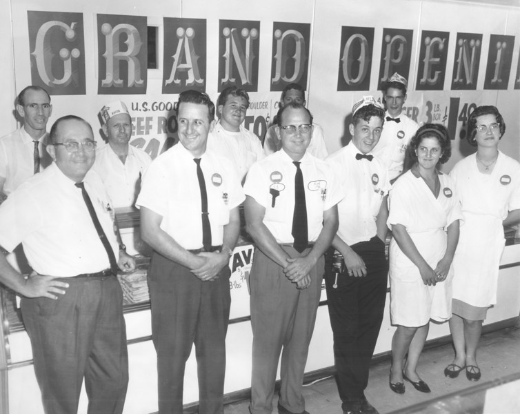 Leon Levin's Grocery grand opening, exact date unknown. Located just south of Square in Nashville, on east side of South Davis Street.<br /> L-R, front row: Leon Levin, owner, A. J. Dorminey,R. J. Rollins,  Tommy Cersey, Jane (Nicholson) Cersey (later owner of Dinner Bell), Jeanatte Griffin Flanders.<br /> L-R, rear: 2nd from left, '______McGee, next, Johnny Rollins.