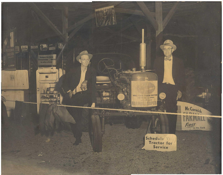William Clark, owner of John Deere Dealership and M.E. Perry, Farmall Dealer at Farmall display of the Berrien County Fair in 1952.