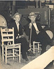 William Clark, John Deere Tractor Dealer and M.E. Perry at John Deere display booth at 1952 Berrien County Fair. Fair was held in Perkins Tobacco Warehouse #4 on the Willacoochee Hwy.