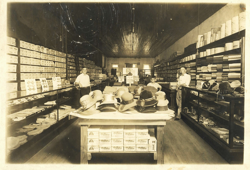 The Morris Bonnett  drygoods store interior. The store was located on the north side of Courthouse Square, attached to the Marion Hotel, and adjacent to the earliest Harveys Grocery Store. The store was located on the downstairs level, a dentist was located above the store. Shown in the photo are left to right: Morris Bonnett, Reuben Bonnett, son of Morris, and an unidentified employee. Photo courtesy of Gary Bonnett, Rockville, Maryland