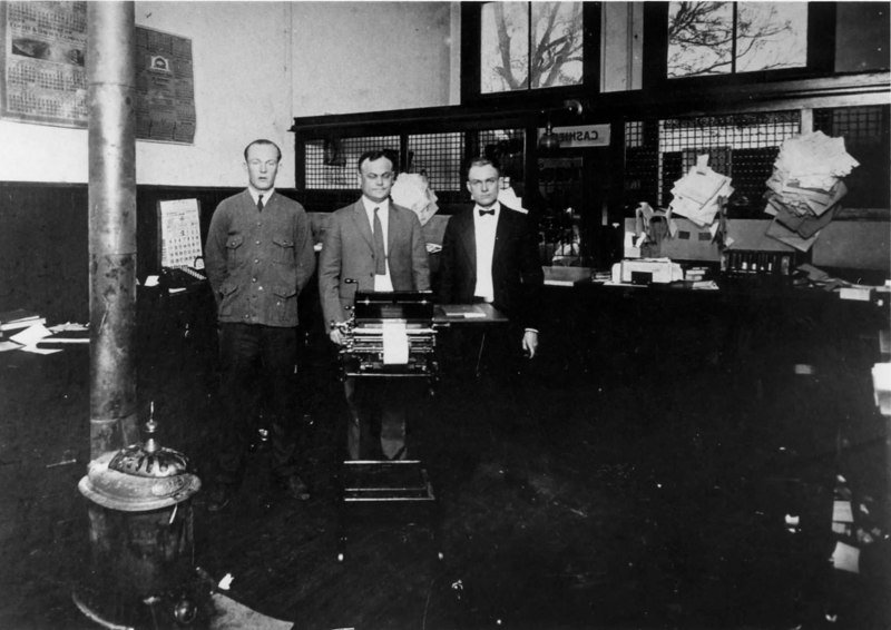 Farmers and Merchants Bank in Milltown. Pictured are employees W. C. Banks, center, and George Patten, right. Individual on left unidentified. Identification requested contact berriencountyga@alltel.net Photo courtesy of W. L. Miller Memorial Library.