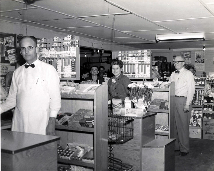 Swindle and Mathis Grocery and Market, Marvin and Mrs. Mathis at cash register's on the corner of Marion and Taylor Streets, about the mid 50s.